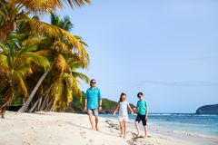 Father with kids at beach. Father and kids enjoying beach vacation on tropical island stock photos