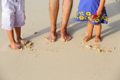 Father and kids feet on beach vacation Royalty Free Stock Photos