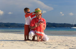 Father with kids having fun on the beach Royalty Free Stock Photography