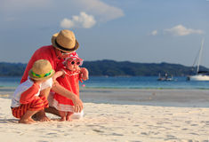 Father with kids having fun on the beach Stock Photography