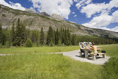 Father and kids having a picnic. Rocky mountains, canada - adobe RGB Royalty Free Stock Photos