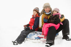 Father and kids having warm drink in snow Stock Photography