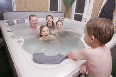 A father and kids in hot tub royalty free stock photography