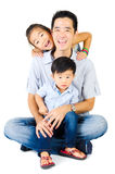 Father and kids. Indoor portrait of asian father and his children Stock Images