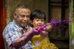 A father and kids Joyful moment of the holi The Festival of Colours in Shakhari bazar, Dhaka, Bangladesh. Shankhari Bazar is located near the intersection of Royalty Free Stock Images