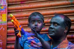 A father and kids Joyful moment of the holi The Festival of Colours in Shakhari bazar, Dhaka, Bangladesh. Shankhari Bazar is located near the intersection of Stock Photography