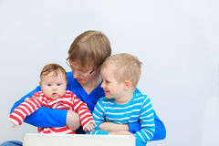 Father with kids with laptop at home Stock Image