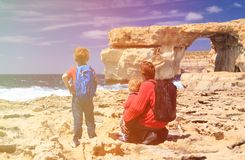 Father and kids looking at Azure Window on Gozo Stock Photos