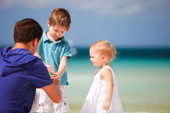 Father and kids making soap bubbles Stock Photography