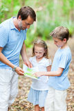 Father and kids with map hiking Royalty Free Stock Images