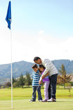 Father and kids playing golf Stock Photo