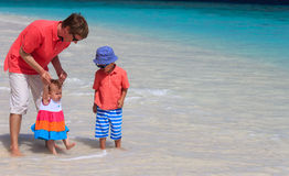 Father and kids playing on sea vacation Stock Images