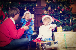 Father and kids with presents at christmas Stock Photography
