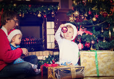 Father and kids with presents at christmas Stock Images