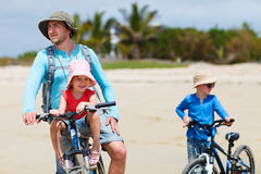 Father and kids riding bikes Royalty Free Stock Photo