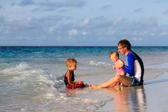 Father and kids on sea vacation Stock Images