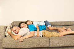 Father and kids sleeping on the sofa Royalty Free Stock Photography