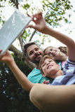 Father and kids taking a selfie with digital tablet Royalty Free Stock Photography