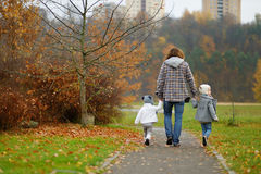 Father and kids taking a walk on autumn day Stock Image