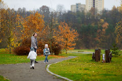 Father and kids taking a walk on autumn day Royalty Free Stock Photography