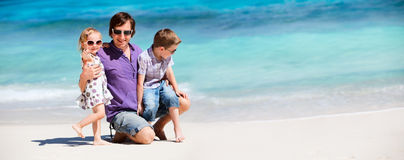 Father with kids on tropical beach Stock Photo