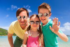 Father and kids. At tropical beach vacation having fun outdoors Royalty Free Stock Photo
