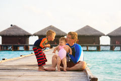 Father with kids on tropical vacation Royalty Free Stock Photography