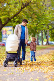 Father with kids walking in city park Stock Image