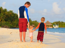 Father with kids walking on tropical resort Stock Photos