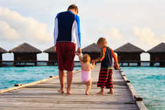 Father with kids walking on tropical resort Royalty Free Stock Photography