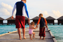 Father with kids walking on tropical resort Royalty Free Stock Photos
