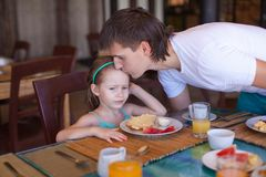 Father kiss his daughter before breakfast in the Stock Image