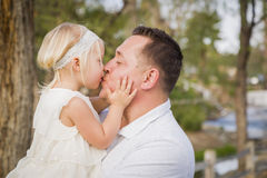 Father Kisses His Cute Baby Girl Outside at the Park Royalty Free Stock Photos