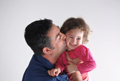 Father kisses his daughter Royalty Free Stock Image