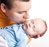 Father kisses his newborn baby Stock Photo