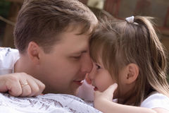 Father kisses his small daughter Royalty Free Stock Photos
