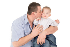 Father kisses little son Royalty Free Stock Photo