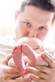 Father kissing baby Stock Image