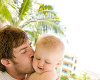 Father Kissing Baby Son Stock Photo