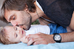 Father kissing baby Stock Photography