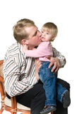 Father kissing a child Stock Photo