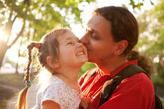 Father kissing daughter. Happy family. Royalty Free Stock Photo
