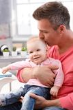 Father kissing happy baby daughter Stock Images