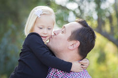Father Kissing His Adorable Little Girl Outdoors. Loving Father Kissing Adorable Little Girl Outdoors Royalty Free Stock Photos