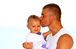 Father kissing his baby girl stock photography