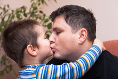 Father kissing his child boy. Closeup of happy father kissing his child boy Stock Photo
