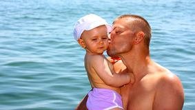 Father kissing his daughter Stock Images
