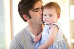Father kissing his daughter. Father kissing his baby daughter on the cheek Stock Photos