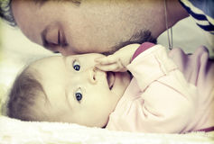 Father kissing his little baby girl Royalty Free Stock Photo