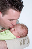 Father kissing his son Royalty Free Stock Photo
